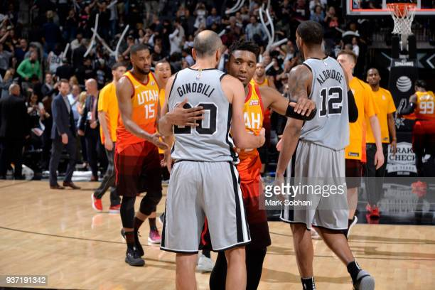 Manu Ginobili of the San Antonio Spurs and Donovan Mitchell of the Utah Jazz hug after the game on March 23 2018 at the ATT Center in San Antonio...