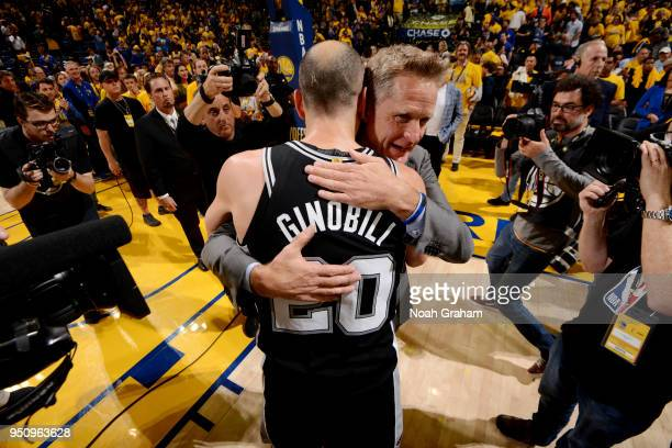 Manu Ginobili of the San Antonio Spurs and Head Coach Steve Kerr of the Golden State Warriors exchange a hug following Game Five of Round One of the...
