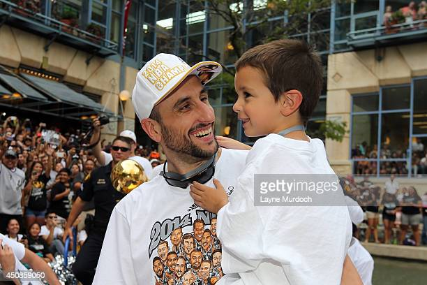 Manu Ginobili of the San Antonio Spurs and his son Dante participate in a victory parade after winning the 2014 NBA Championship on June 18 2014 in...