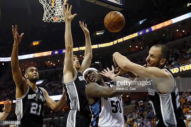 Manu Ginobili of the San Antonio Spurs and Zach Randolph of the Memphis Grizzlies battle for the ball in the second half during Game Three of the...