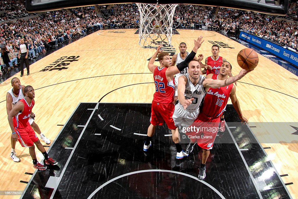 Manu Ginobili #20 of the San Antonio Spurs attempts a layup against Blake Griffin #32 and Ryan Hollins #15 of the Los Angeles Clippers on November 19, 2012 at the AT&T Center in San Antonio, Texas.