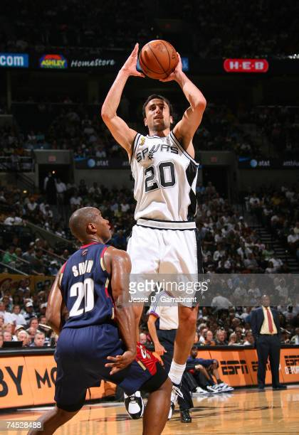 Manu Ginobili of the San Antonio Spurs attempts a shot against Eric Snow of the Cleveland Cavaliers in Game Two of the NBA Finals at the ATT Center...