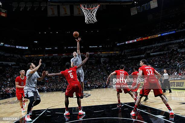 Manu Ginobili of the San Antonio Spurs attempts a shot during a game against the Houston Rockets on December 25 2013 at the ATT Center in San Antonio...