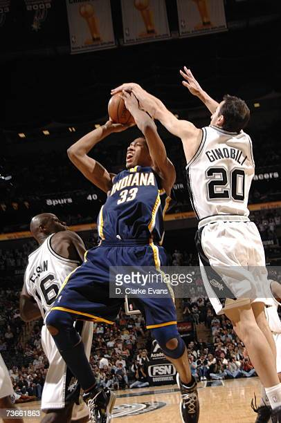Manu Ginobili of the San Antonio Spurs blocks Danny Granger of the Indiana Pacers during the game at the ATT Center on March 21 2007 in San Antonio...