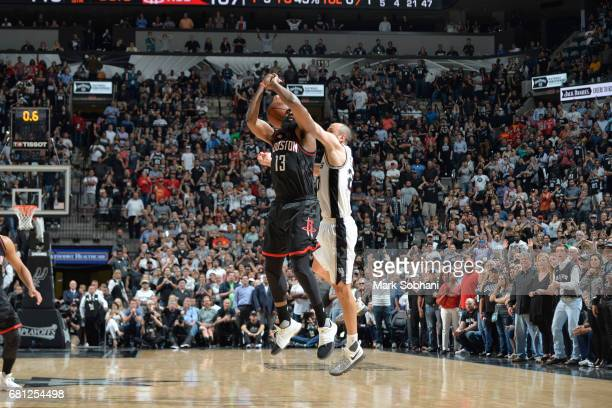 Manu Ginobili of the San Antonio Spurs blocks the shot of James Harden of the Houston Rockets in Game Five of the Western Conference Semifinals on...