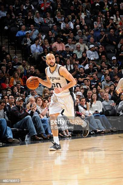 Manu Ginobili of the San Antonio Spurs brings the ball up court against the Los Angeles Clippers on December 22 2014 at the ATT Center in San Antonio...