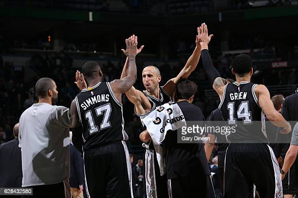 Manu Ginobili of the San Antonio Spurs celebrates with his teammates after the game against the Milwaukee Bucks on December 5 2016 at the BMO Harris...