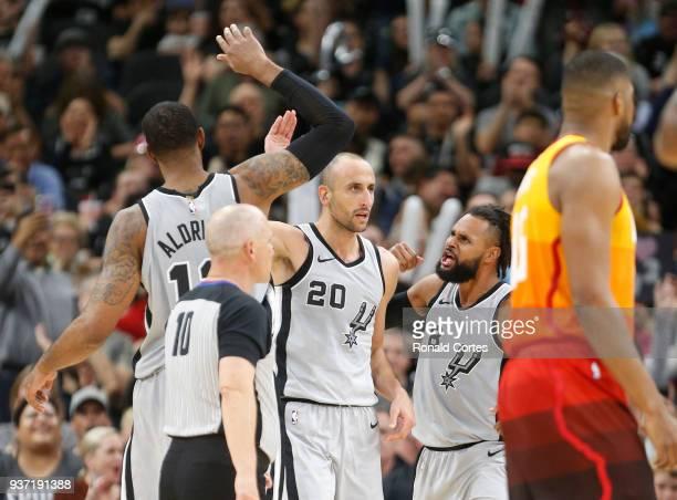 Manu Ginobili of the San Antonio Spurs celebrates with LaMarcus Aldridge of the San Antonio Spurs and Patty Mills of the San Antonio Spurs after a...