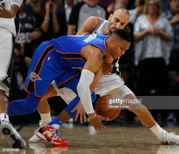 Manu Ginobili of the San Antonio Spurs does not allow Russell Westbrook of the Oklahoma City Thunder to get a shot away in closing seconds at ATT...