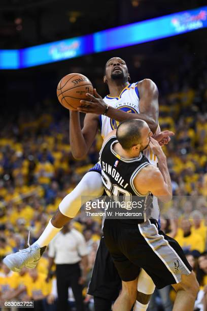 Manu Ginobili of the San Antonio Spurs draws a charge from Kevin Durant of the Golden State Warriors during Game One of the NBA Western Conference...