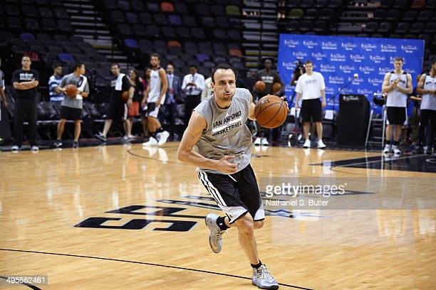 Manu Ginobili of the San Antonio Spurs dribbles during practice as part of the 2014 NBA Finals on June 04 2014 at ATT Center in San Antonio Texas...
