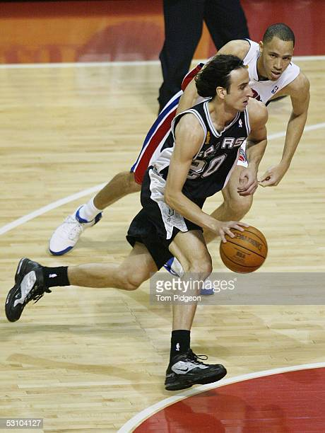 Manu Ginobili of the San Antonio Spurs dribbles past Tayshaun Prince of the Detroit Pistons in the first quarter in Game five of the 2005 NBA Finals...