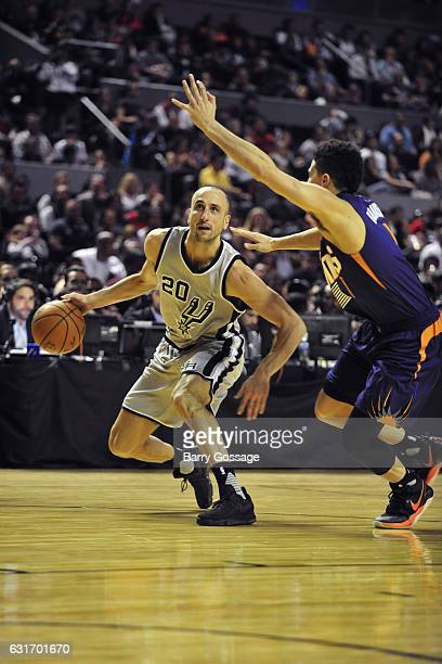 Manu Ginobili of the San Antonio Spurs dribbles the ball against the Phoenix Suns as part of NBA Global Games at Arena Ciudad de Mexico on January...