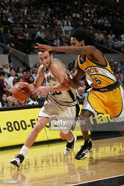 Manu Ginobili of the San Antonio Spurs drives against Mickael Gelabale of the Seattle Supersonics during the game at the ATT Center April 3 2007 in...