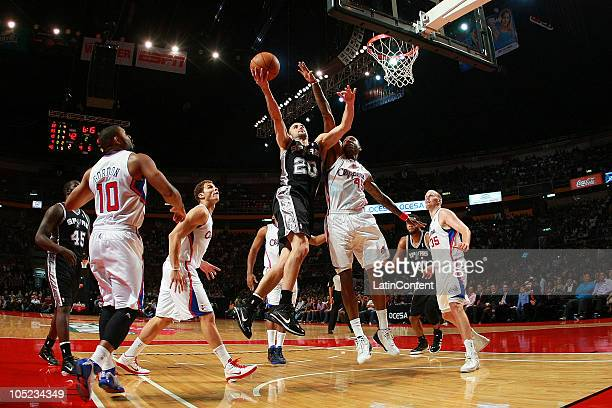 Manu Ginobili of the San Antonio Spurs drives against Rasual Butler of the Los Angeles Clippers during a preseason game on October 12 2010 at the...