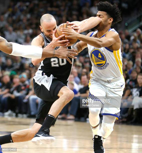 Manu Ginobili of the San Antonio Spurs drives on Quinn Cook of the Golden State Warriors during the first half of Game Four of Round One of the 2018...