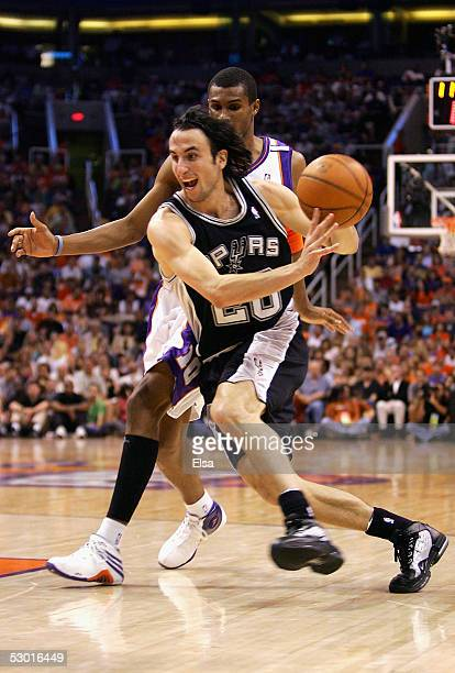 Manu Ginobili of the San Antonio Spurs drives past Leandro Barbosa of the Phoenix Suns in Game one of the Western Conference Finals during the 2005...