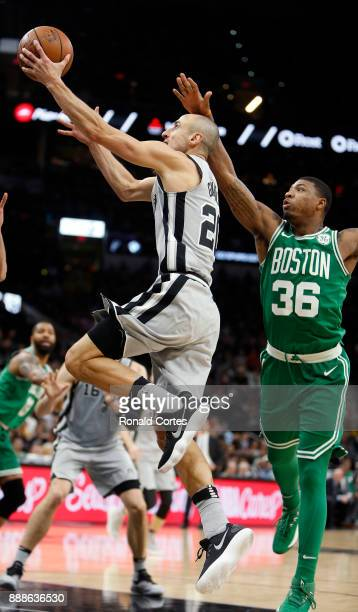 Manu Ginobili of the San Antonio Spurs drives past Marcus Smart of the Boston Celtics at ATT Center on December 08 2017 in San Antonio Texas NOTE TO...