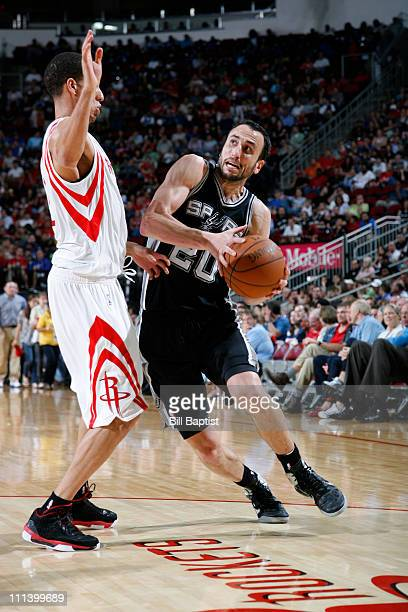 Manu Ginobili of the San Antonio Spurs drives the ball past Kevin Martin of the Houston Rockets on April 1 2011 at the Toyota Center in Houston Texas...