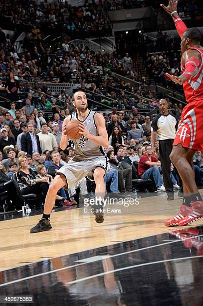 Manu Ginobili of the San Antonio Spurs drives to the basket against the Houston Rockets at the ATT Center on November 30 2013 in San Antonio Texas...