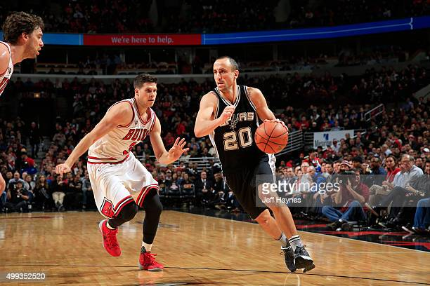 Manu Ginobili of the San Antonio Spurs drives to the basket against the Chicago Bulls during the game on November 30 2015 at United Center in Chicago...
