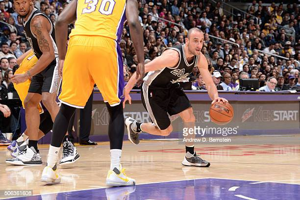Manu Ginobili of the San Antonio Spurs drives to the basket against the Los Angeles Lakers during the game on January 22 2016 at STAPLES Center in...