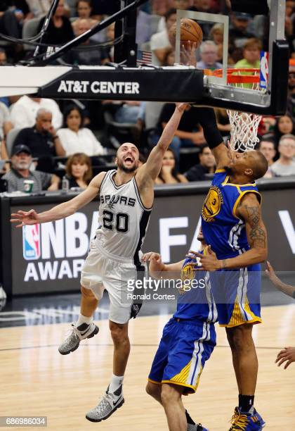 Manu Ginobili of the San Antonio Spurs drives to the basket against David West of the Golden State Warriors in the first half during Game Four of the...