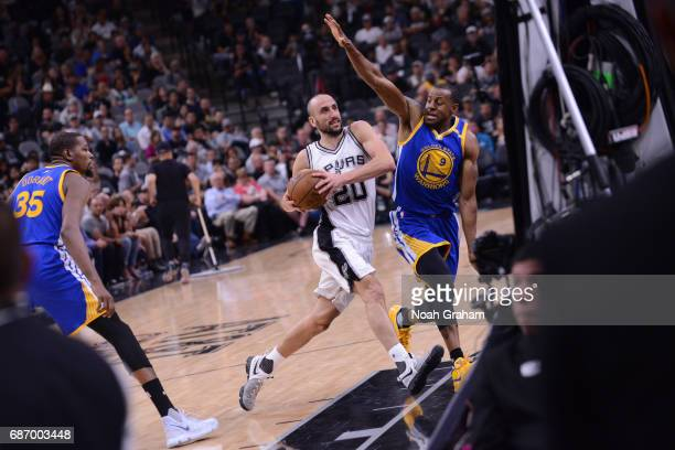 Manu Ginobili of the San Antonio Spurs drives to the basket against the Golden State Warriors during Game Four of the Western Conference Finals of...