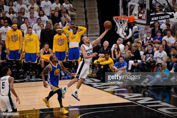Manu Ginobili of the San Antonio Spurs drives to the basket against the Golden State Warriors in Game Four of the Western Conference Finals during...