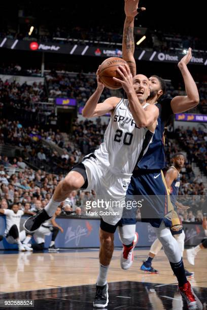 Manu Ginobili of the San Antonio Spurs drives to the basket against the New Orleans Pelicans on March 15 2018 at the ATT Center in San Antonio Texas...