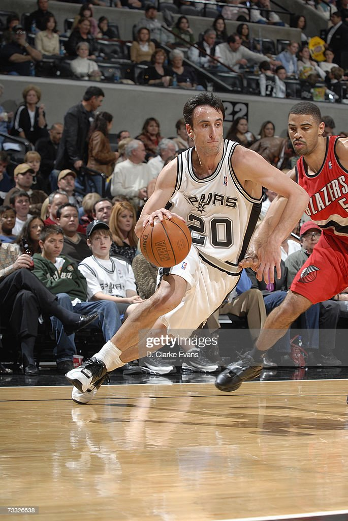 Manu Ginobili #20 of the San Antonio Spurs drives to the paint past Ime Udoka #5 of the Portland Trail Blazers on January 9, 2007 at AT&T Center in San Antonio, Texas. The Spurs won 98-84.