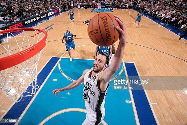 Manu Ginobili of the San Antonio Spurs dunks against the Dallas Mavericks on March 18 2011 at the American Airlines Center in Dallas Texas NOTE TO...