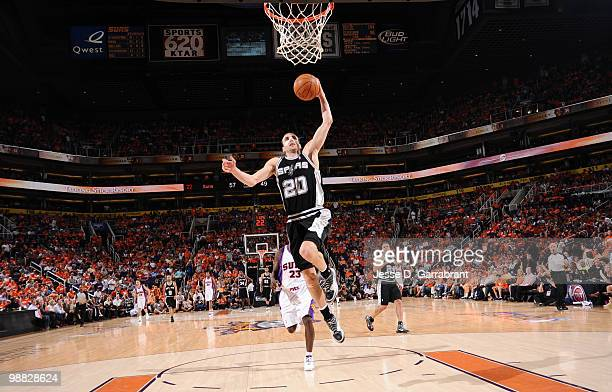 Manu Ginobili of the San Antonio Spurs dunks against the Phoenix Suns in Game One of the Western Conference Semifinals during the 2010 NBA Playoffs...