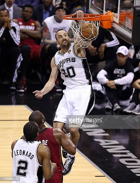 Manu Ginobili of the San Antonio Spurs dunks the ball in the second half while taking on the Miami Heat during Game Three of the 2013 NBA Finals at...