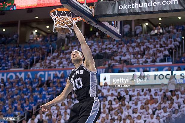 Manu Ginobili of the San Antonio Spurs dunks two points against the Oklahoma City Thunder during the first half of Game Three of the Western...