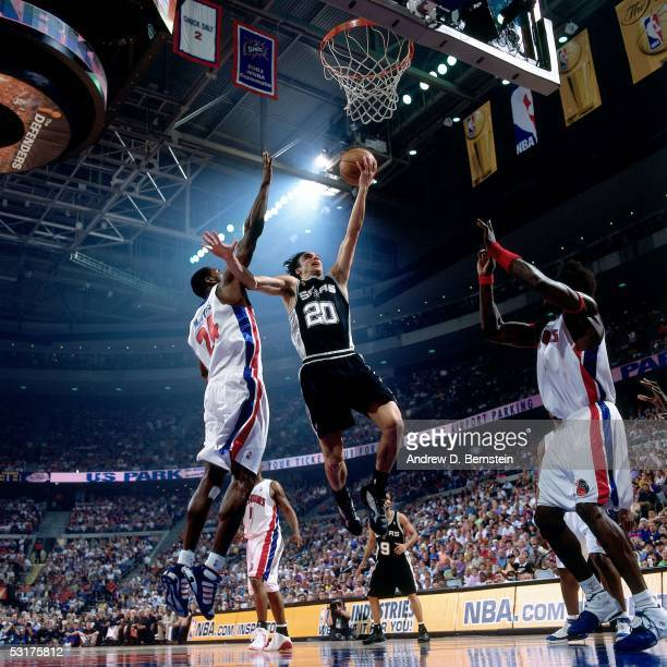 Manu Ginobili of the San Antonio Spurs goes for a layup against Antonio McDyess and Ben Wallace of the Detroit Pistons in Game Five of the 2005 NBA...