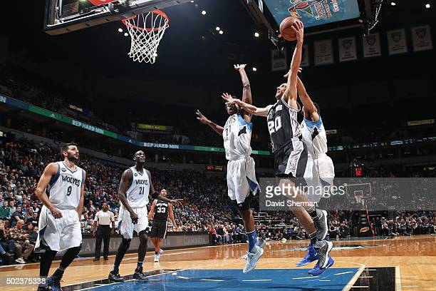 Manu Ginobili of the San Antonio Spurs goes for the dunk against the Minnesota Timberwolves during the game on December 23 2015 at Target Center in...