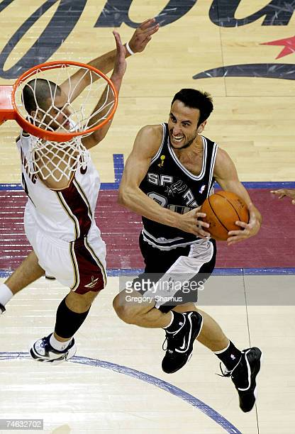 Manu Ginobili of the San Antonio Spurs goes in for layup over Sasha Pavlovic of the Cleveland Cavaliers during Game Four of the NBA Finals on June...