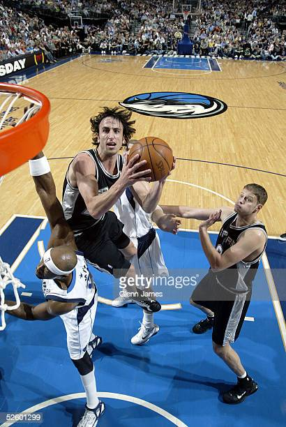 Manu Ginobili of the San Antonio Spurs goes into the lane for a layup over Erick Dampier of the Dallas Mavericks on April 7, 2005 at the American...