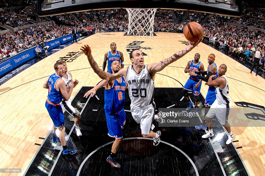 Manu Ginobili #20 of the San Antonio Spurs goes to the basket against Tyson Chandler #6 of the New York Knicks on November 15, 2012 at the AT&T Center in San Antonio, Texas.