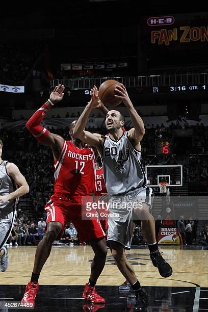 Manu Ginobili of the San Antonio Spurs goes to the basket against the Houston Rockets on November 30 2013 at the ATT Center in San Antonio Texas NOTE...