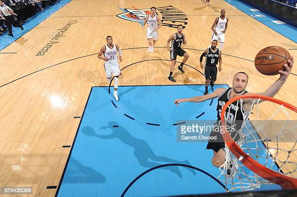 Manu Ginobili of the San Antonio Spurs goes to the basket against the Oklahoma City Thunder in Game Four of the Western Conference Semifinals during...