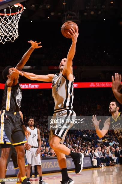 Manu Ginobili of the San Antonio Spurs goes to the basket against the Golden State Warriors on February 10 2018 at ORACLE Arena in Oakland California...