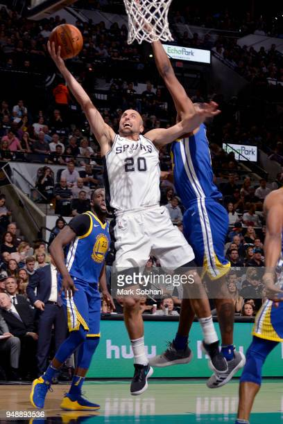 Manu Ginobili of the San Antonio Spurs goes to the basket against the Golden State Warriors during Game Three of the Western Conference Quarterfinals...