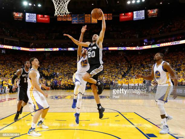 Manu Ginobili of the San Antonio Spurs goes up for a shot against the Golden State Warriors during Game One of the NBA Western Conference Finals at...