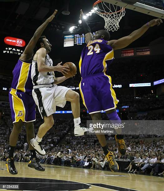 Manu Ginobili of the San Antonio Spurs goes up for a shot between Ronny Turiaf and Kobe Bryant of the Los Angeles Lakers in Game Three of the Western...