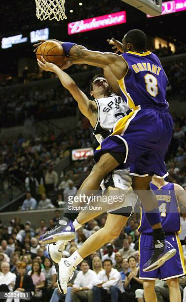 Manu Ginobili of the San Antonio Spurs goes up for a shot defended by Kobe Bryant of the Los Angeles Lakers during game five of the Western...