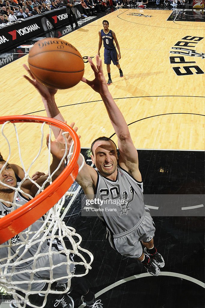 Manu Ginobili #20 of the San Antonio Spurs grabs a rebound against the New Orleans Pelicans at the AT&T Center on March 29, 2014 in San Antonio, Texas.