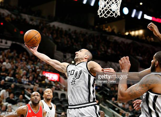 Manu Ginobili of the San Antonio Spurs grabs a rebound against the Toronto Raptors at ATT Center on April 2 2016 in San Antonio Texas NOTE TO USER...