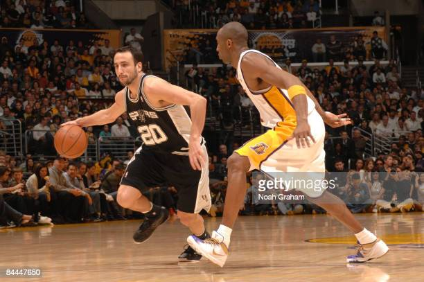 Manu Ginobili of the San Antonio Spurs handles the ball against Kobe Bryant of the Los Angeles Lakers at Staples Center on January 25 2009 in Los...